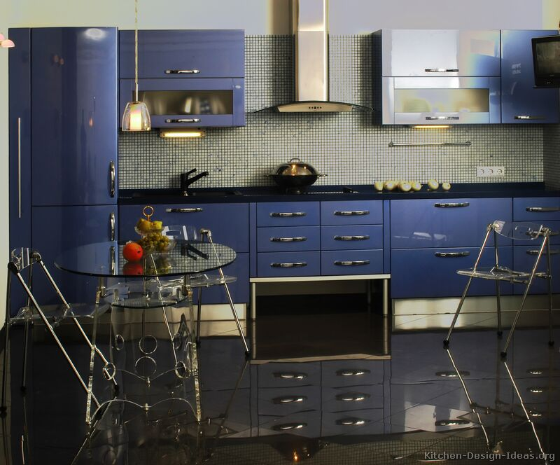 A luxurious modern design with glossy blue kitchen cabinets and metallic accents.