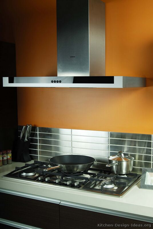 Dark kitchen cabinets with orange walls for Dark orange kitchen