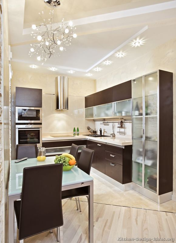 A small kitchen design with modern wood cabinets for Dark wood cabinets small kitchen