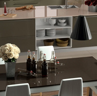 Modern Kitchen Table next to a Gray Island with Beige Quartz Countertops