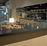 A Modern Showroom Kitchen with Compac Nocturno Quartz Countertops