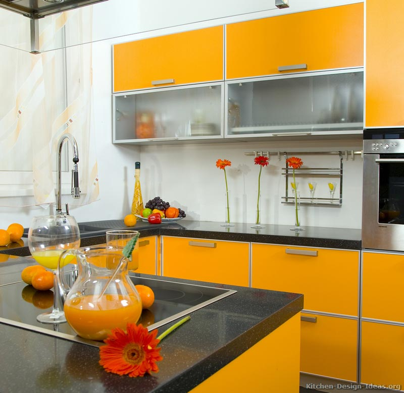 Modern Orange Kitchen with Black Countertops and Fruit Decor