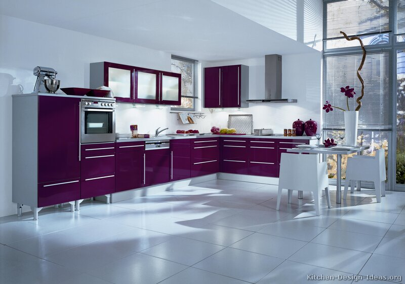 A modern kitchen with deep purple cabinets and white floors & walls