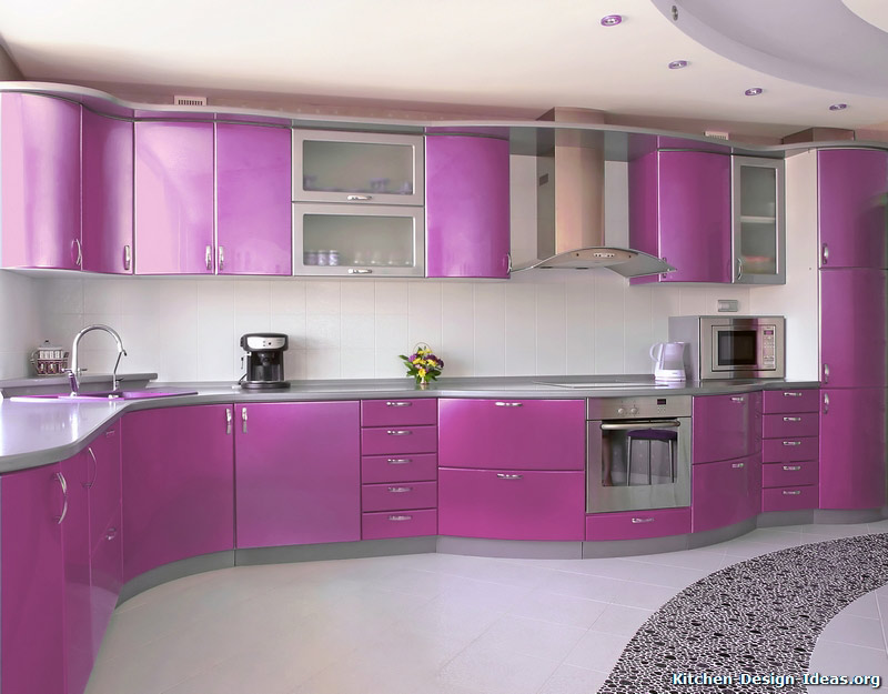 Curved metallic purple cabinets are the focal point of this modern kitchen.