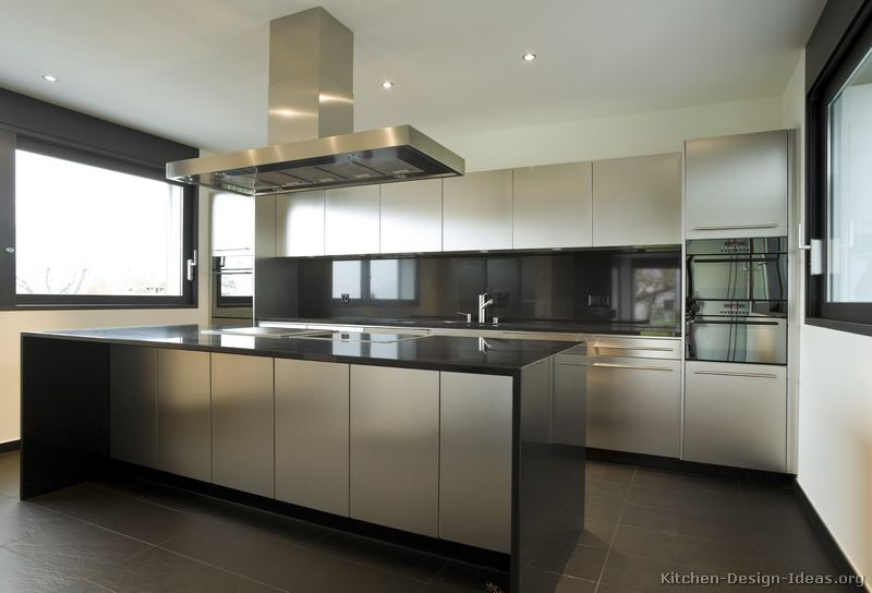 Stainless steel kitchen cabinets with black granite for Kitchen stainless steel cabinets
