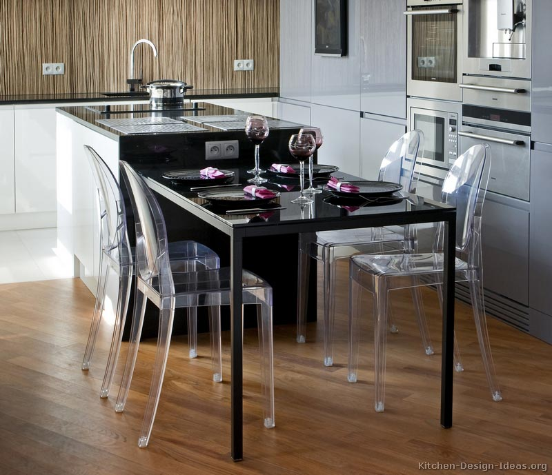 Modern Luxury Kitchen with Black Island Table and Plexiglass Chairs