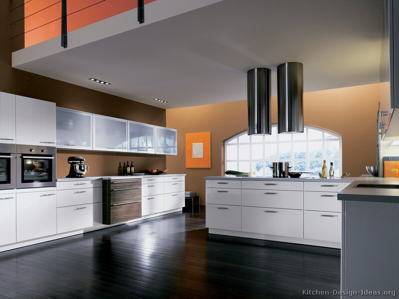 A contemporary two tone kitchen under a loft for Modern cabinets