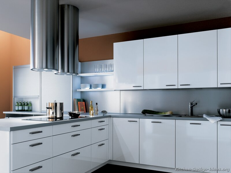 White Cabinets, Gray Countertops, And Sleek Twin Chimney Hoods In Stainless  Steel