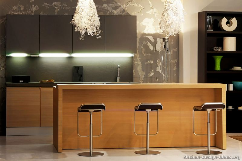 Decorative chandeliers look like snowflake clusters over the modern kitchen island