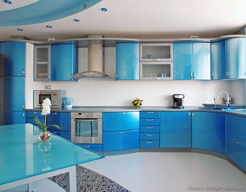 This modern metallic blue kitchen features curved cabinets, gray