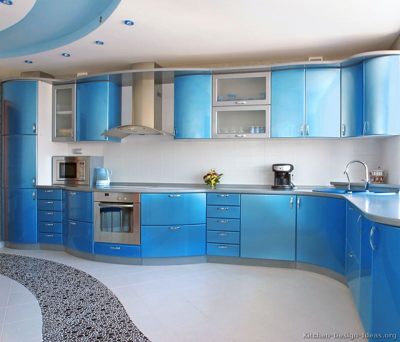 this modern metallic blue kitchen features curved cabinets gray