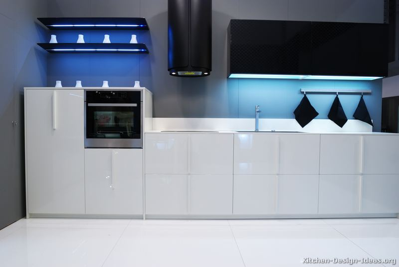 Ultra Modern Black & White Kitchen: White base cabinets with black upper cabinets and hood