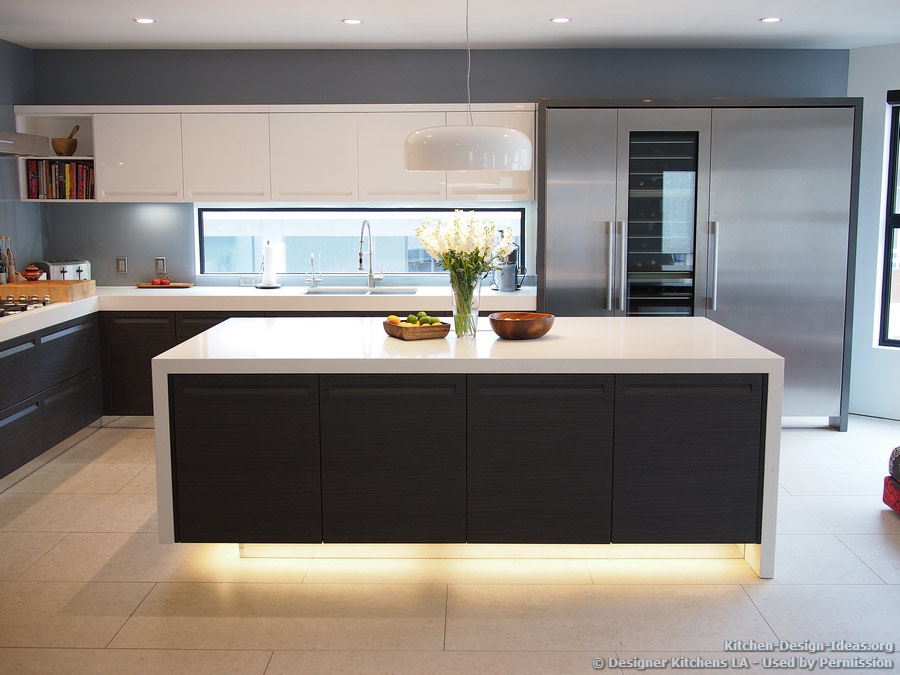Modern Kitchen with Luxury Appliances, Black & White Cabinets, Island Lighting, and a Backsplash Window