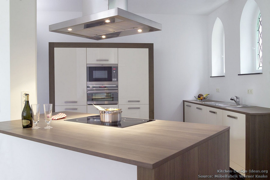 Minimalist Kitchen With Cream Cabinets And Walnut Wood Countertops  Complements The Gothic Arches Of This Historic