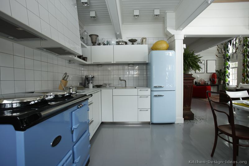 A blue retro-style refrigerator and AGA stove add a classic feel to this kitchen & Retro Kitchen Designs - Pictures and Ideas
