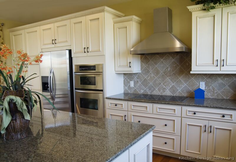 Pictures of kitchens traditional off white antique for Kitchen remodel ideas with white cabinets
