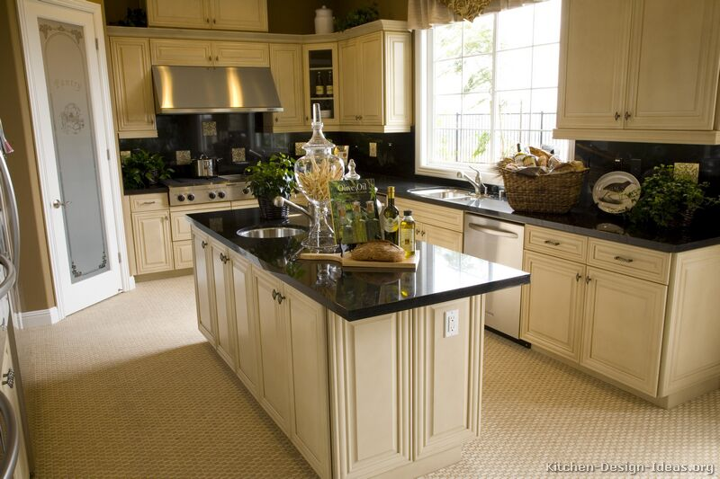 Pictures of kitchens traditional off white antique for Black and white kitchen cabinet designs