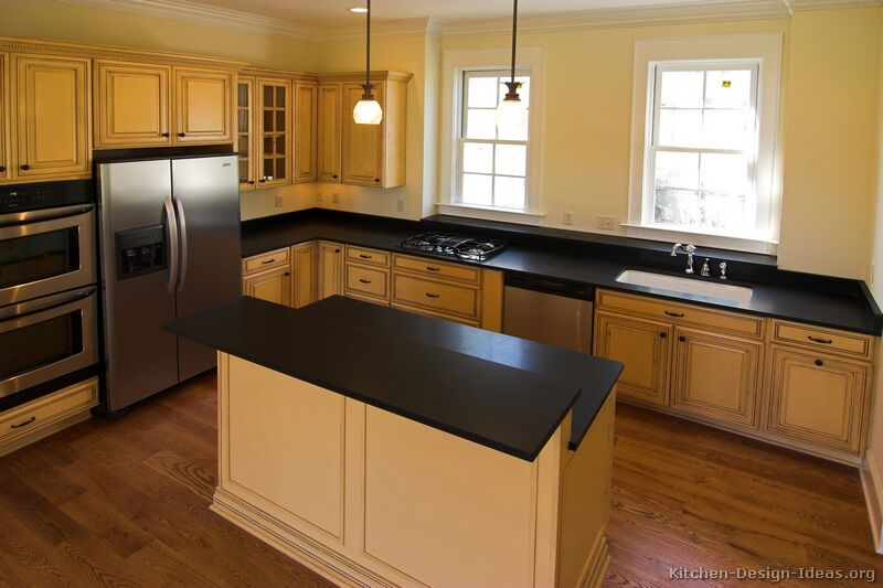 Pictures of kitchens traditional off white antique for Kitchen ideas with black granite countertops