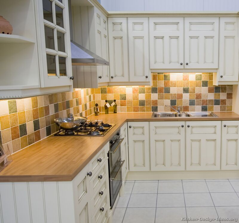 Pictures of kitchens traditional off white antique for White kitchen cabinets what color backsplash