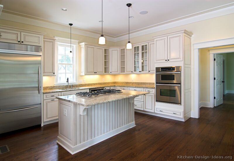 Pictures of kitchens traditional off white antique for White kitchen cabinets with hardwood floors