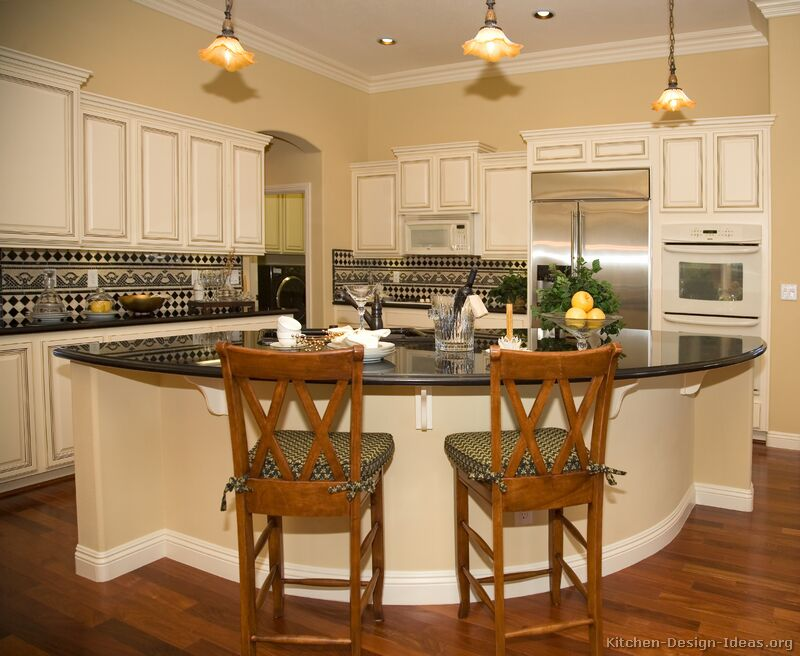 Pictures of kitchens traditional off white antique for Different shaped kitchen island designs with seating
