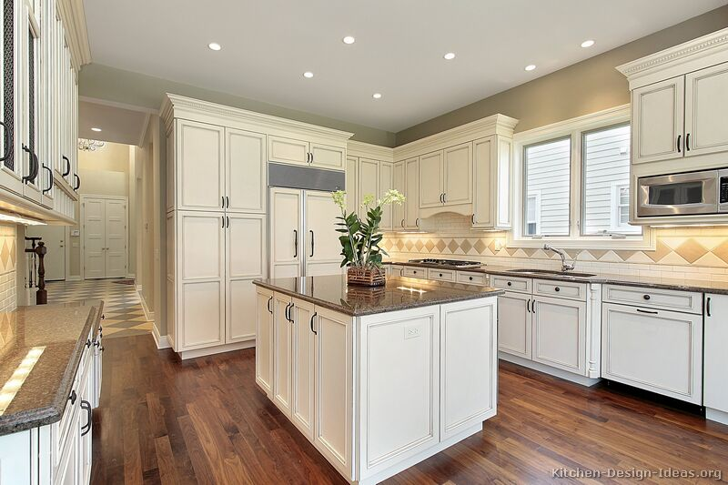 Pictures of kitchens traditional off white antique for Traditional white kitchen cabinets