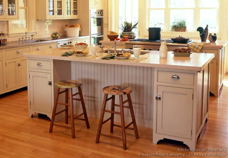 Pictures of kitchens traditional off white antique for How to build a kitchen island with seating
