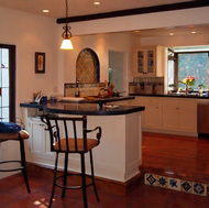 Spanish Tile Floor & Backsplash, Wrought Iron Bar Stools - Designer Kitchens LA