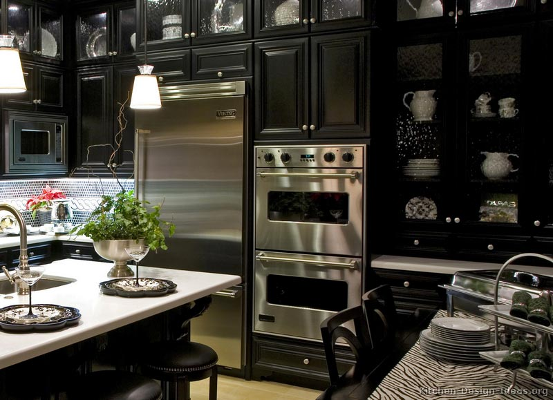 Luxury black kitchen cabinets with pure white countertops for Black kitchen cabinets images