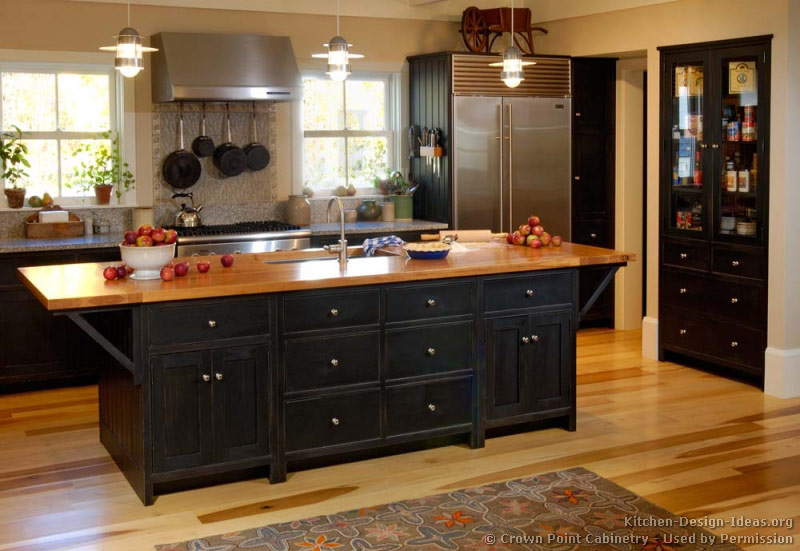 Pictures of kitchens traditional black kitchen for Country kitchen cabinets
