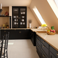 A Traditional Black Kitchen with Low Vaulted Ceilings and Beige Compac Quartz Countertops