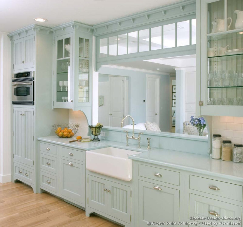 Charmant A Pale Blue Victorian Kitchen With Matching Blue Countertops, A White Apron  Sink, Glass