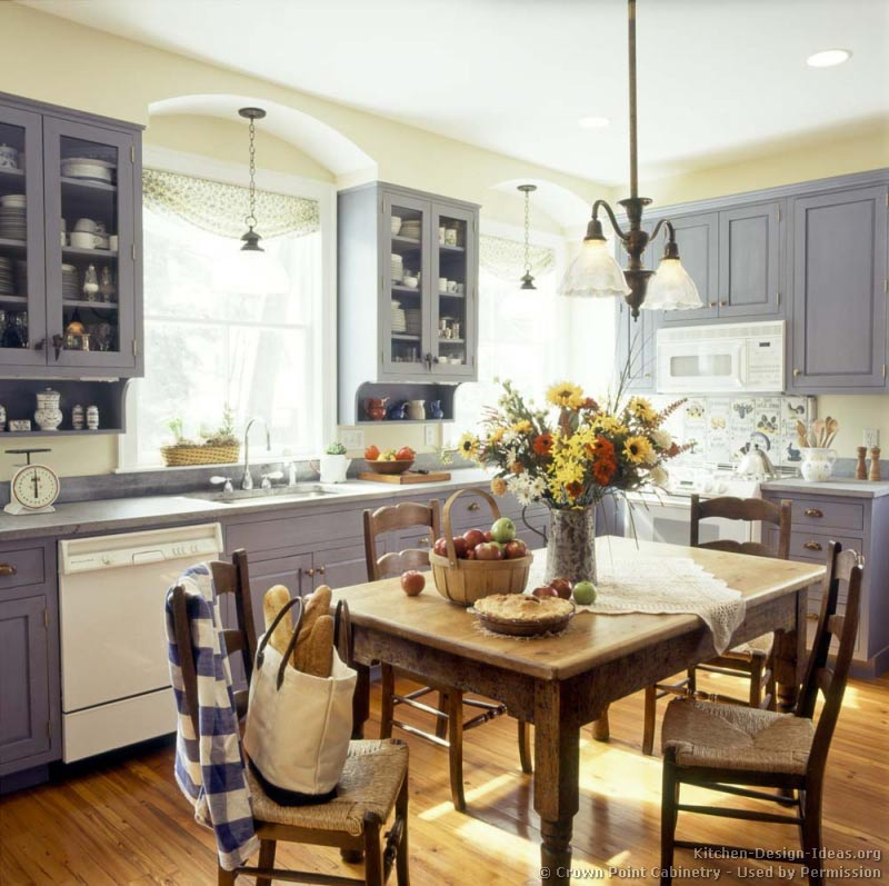Weathered blue shaker cabinets, gray soapstone countertops, knotty