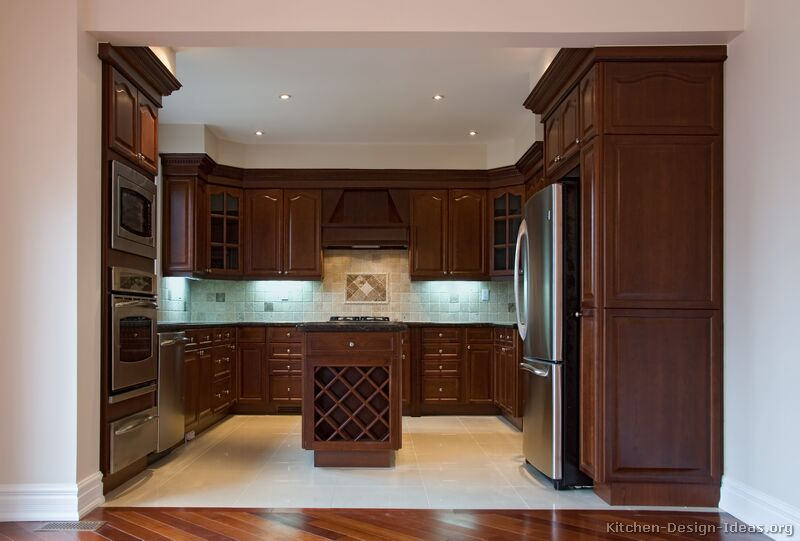 kitchens featuring dark cherry colored wood cabinets in traditional