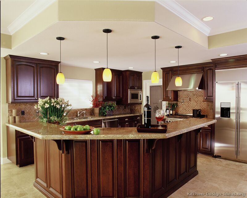 A luxury kitchen with cherry cabinets and a large island for How much can granite overhang without support