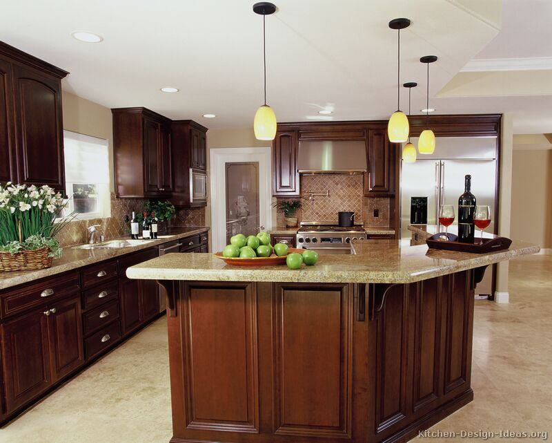 Luxury Cherry Kitchen with a Travertine Floor and Backsplash