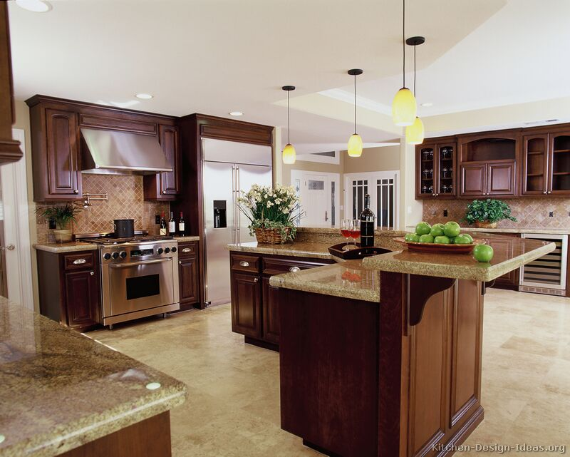 A Luxury Kitchen With Cherry Cabinets And A Large Island Bar