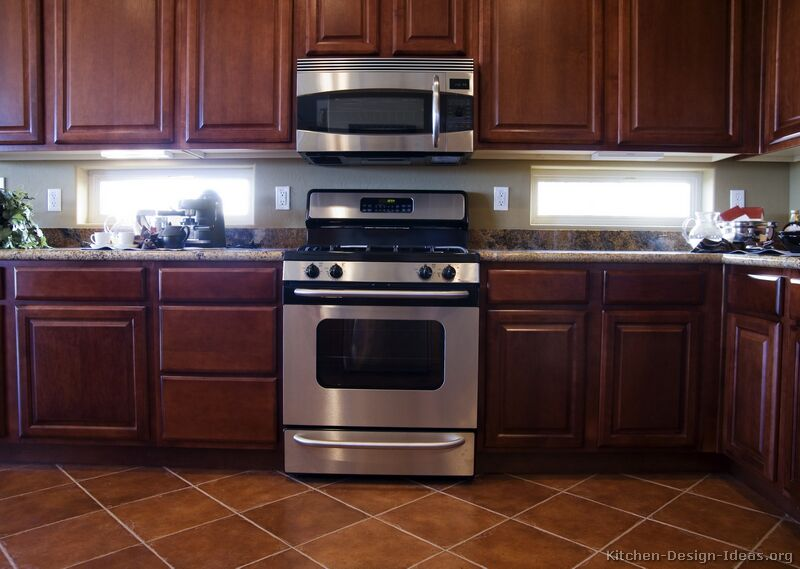 Cherry kitchen caninets and backsplashes ideas best home for Traditional dark kitchen cabinets