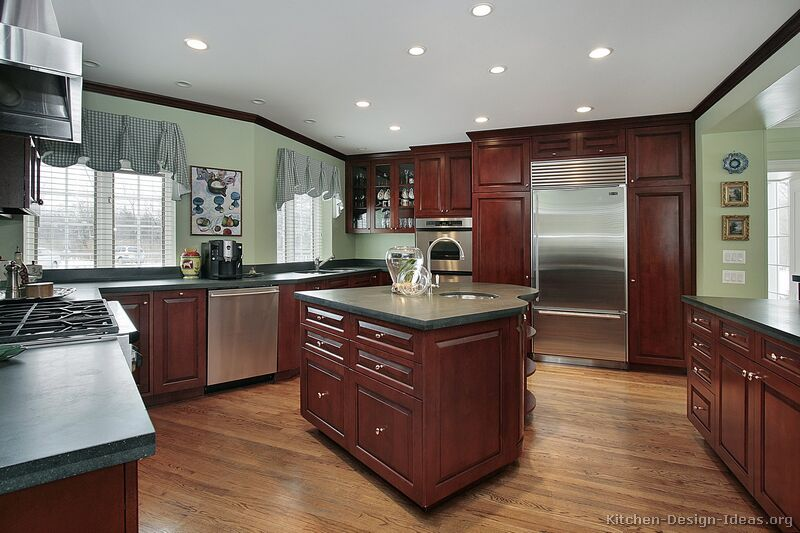 Pictures of kitchens traditional dark wood kitchens for Cherry kitchen cabinets wall color