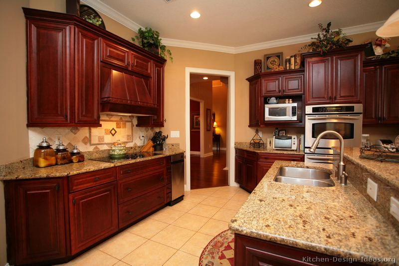 Pictures of kitchens traditional dark wood cherry for Cherry kitchen cabinets wall color