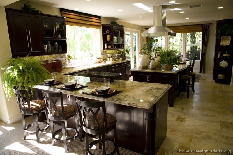 Dark Wood Cabinets And Lots Of Natural Light Combine Nicely In This Welcoming Kitchen