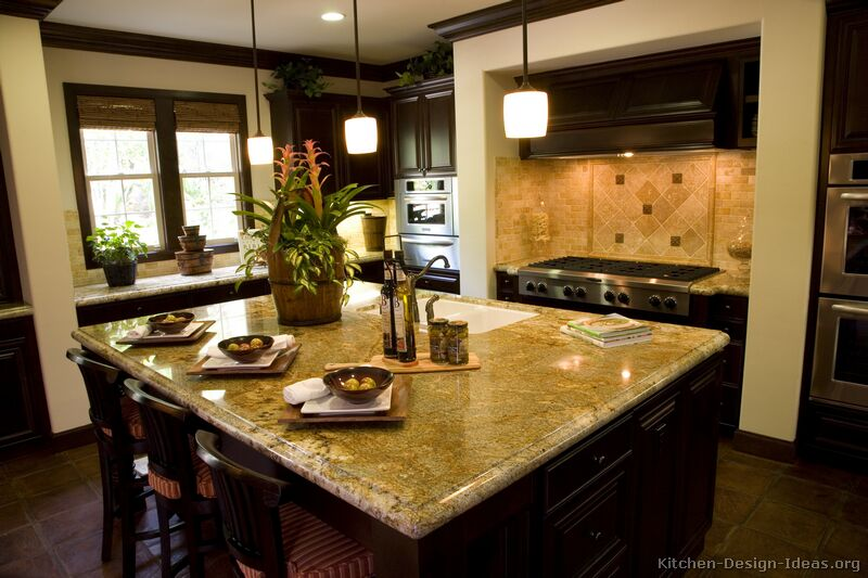 Granite countertop colors gold granite for Dark kitchen design ideas