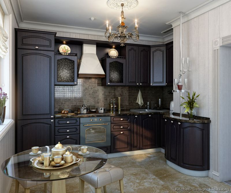 Rich espresso cabinets give this small European kitchen a luxurious feel.