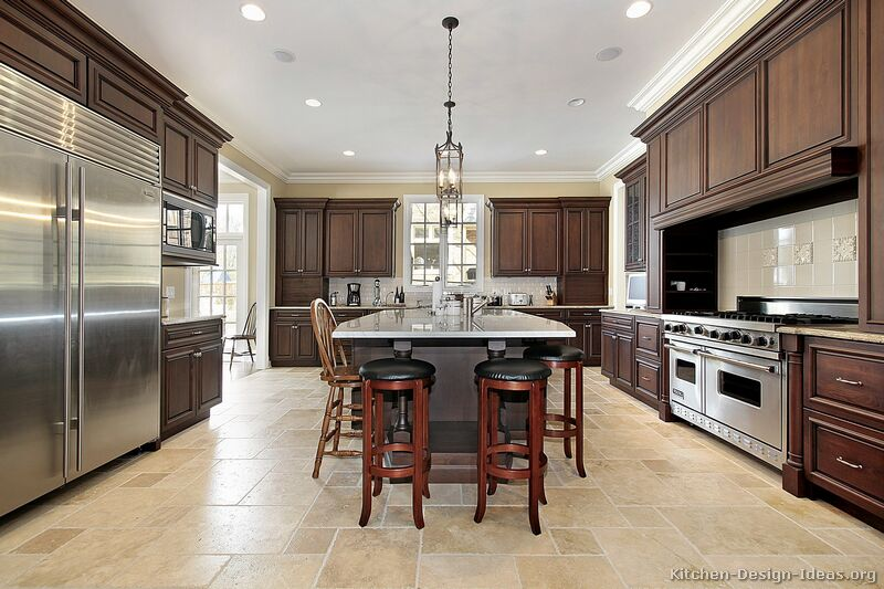A large luxury kitchen design with dark walnut stained Luxury kitchen flooring