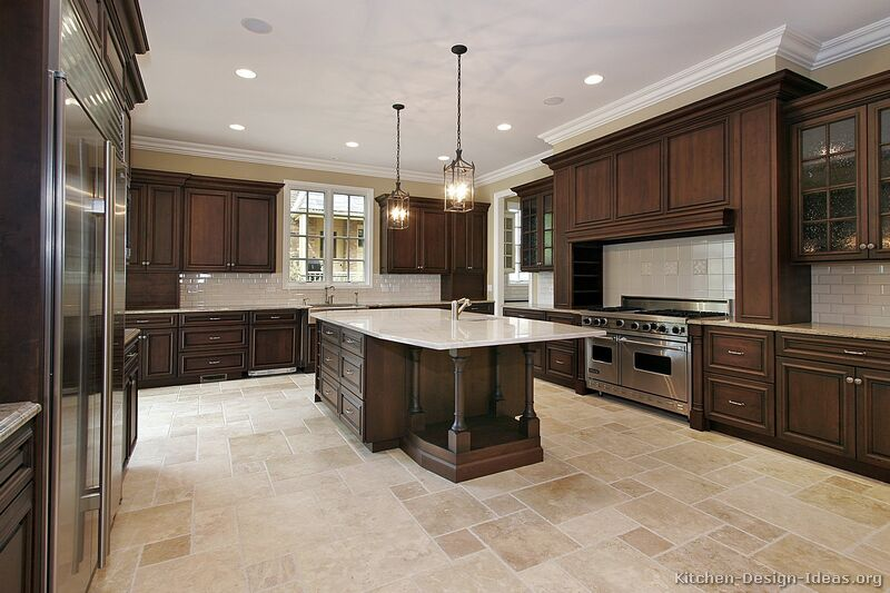 This expansive kitchen features travertine floor tiles in various