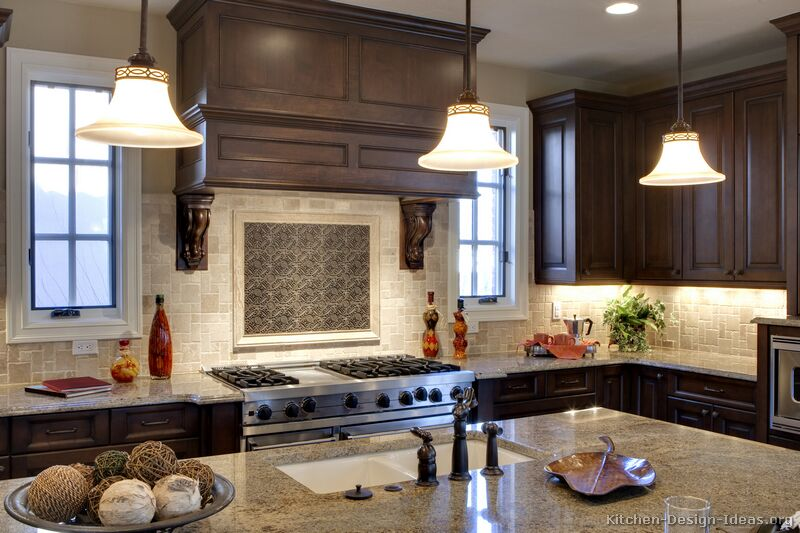 Classic wood hood with tumbled travertine and contrasting metal tile backsplash