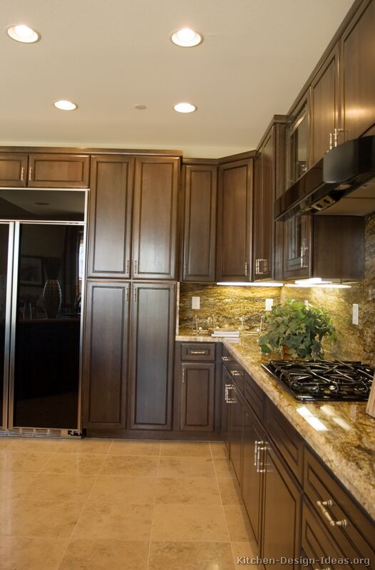 Pictures of kitchens traditional dark wood kitchens for Granite colors for black cabinets