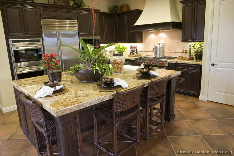 kitchens featuring dark walnut colored wood cabinets in traditional