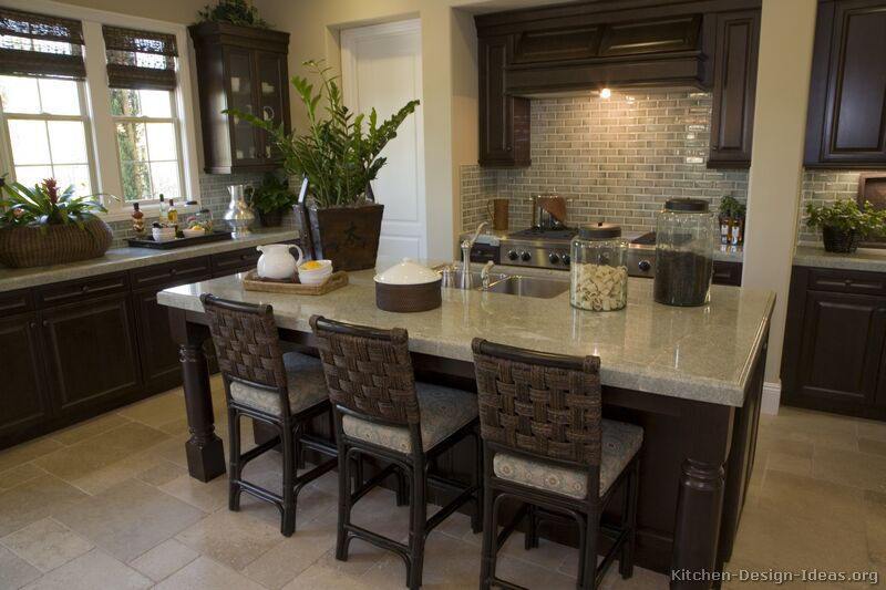Kitchen counter-height rattan bar stools in a dark tobacco finish with woven backrests and upholstered seats
