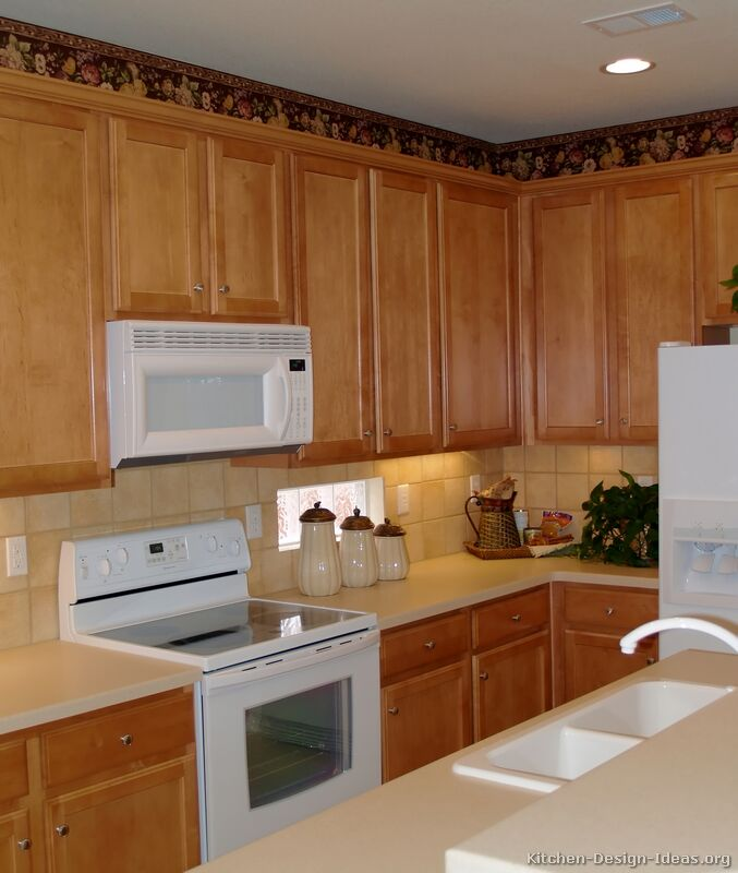 Pictures of kitchens traditional light wood kitchen for Kitchen designs with white appliances